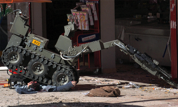 A bomb disposal robot at Dimona in Israel running over the corpse of a dead man Photo by Haim Horenstein