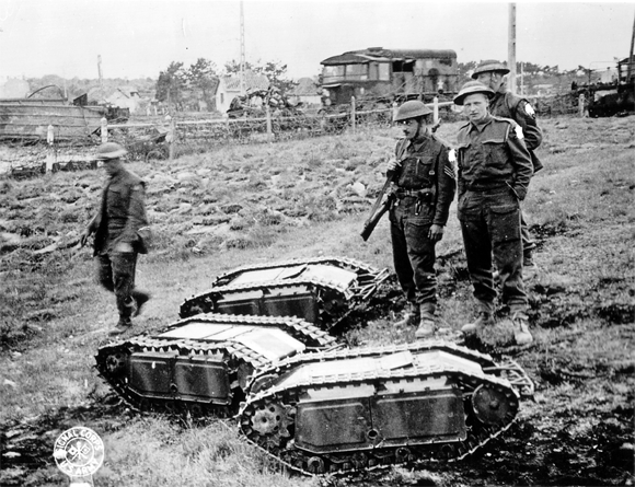 British soldiers with three captured Goliath units during the Battle of Normandy in 1944