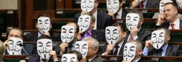 Cut-out Guy-Fawkes paper masks in the Polish parliament