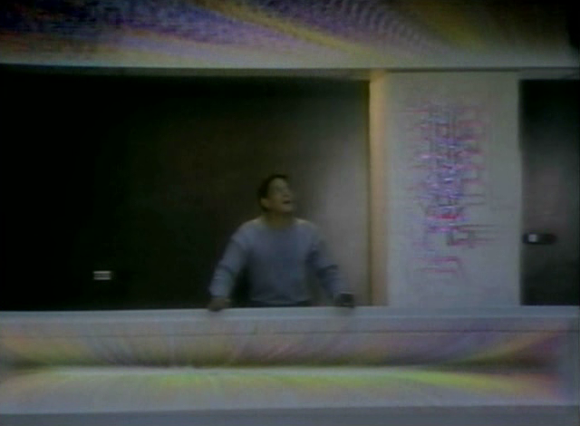 Raúl Juliá as Aram Fingal realizing the virtual reality around him in 'Overdrawn at the Memory Bank' (Williams 1983)