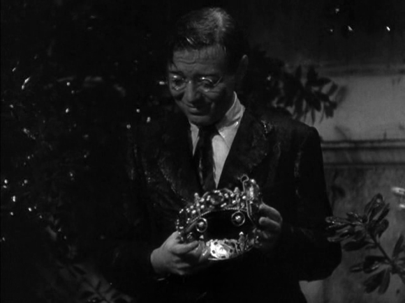 Mr. Moto (Peter Lorre) with the crown of Bilqis, Queen of Sheba, in 'Mr. Moto takes a Vacation' (Foster 1939)