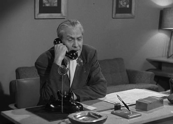 "Doctor Wernher (Larry Johns) on a wireless phone in Richard Talmadge's 1953 movie ""Project Moon Base"""