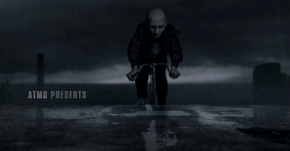Roger cycling through the rain during the opening credits of 'Metropia' (Saleh 2009)